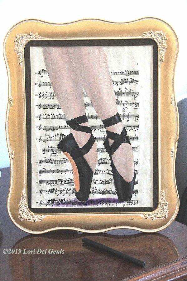 'Balance' - A ballerina's feet in black toe shoes on a background of 'Balance' - A ballerina's feet in black toe shoes on vintage sheet music; oil painting wall or desk art by Lori Del Genis (2019); framed oil painting wall or desk art by Lori Del Genis.